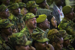 Members of the military shed a tear during a state ceremony for assassinated army chief Gen. Seare Mekonnen, at the Millennium Hall in the capital Addis Ababa, Ethiopia Tuesday, June 25, 2019. Ethiopia's Prime Minister Abiy Ahmed sobbed openly at the service Tuesday for the military chief who was assassinated by his own bodyguard over the weekend. (AP Photo/Mulugeta Ayene)