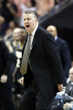 Purdue head coach Matt Painter yells to his players during the second half of a men's NCAA Tournament college basketball South Regional semifinal game against Tennessee Thursday, March 28, 2019, in Louisville, Ky. (AP Photo/Michael Conroy)