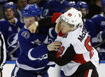 Ottawa Senators left wing Max McCormick (89) connects with a punch as he fights Tampa Bay Lightning left wing Adam Erne (73) during the first period of an NHL hockey game Tuesday, March 13, 2018, in Tampa, Fla. (AP Photo/Chris O'Meara)