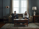 This image released by A24 shows Ethan Hawke, left, and Amanda Seyfriend in a scene from