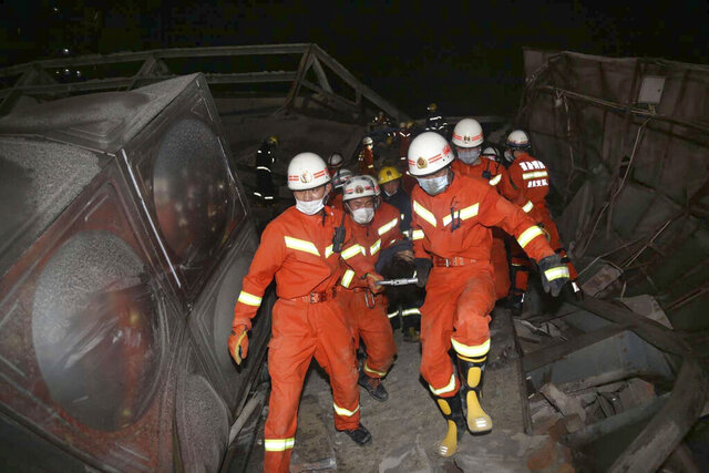 Rescuers evacuate an injured person from the rubble of a collapsed hotel building in Quanzhou city in southeast China's Fujian province Saturday, March 07, 2020. The hotel used for medical observation of people who had contact with coronavirus patients collapsed in southeastern China on Saturday, trapping dozens, state media reported. (Chinatopix Via AP)