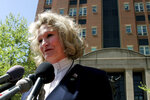 FILE - In this April 20, 2006, file photo, Alice Hoagland, whose son Mark Bingham died on United Airline's Flight 93 on Sept. 11, 2001, speaks to reporters in front of U.S. District Court in Alexandria, Va. Hoagland, beloved as a mother figure by players in the global gay rugby movement her own son Mark Bingham helped establish shortly before he perished as one of the heroes of Flight 93, died Dec. 22, 2020, in her sleep at her home in California after battling Addison's disease. (AP Photo/Caleb Jones, File)