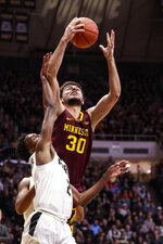 Minnesota guard Bryan Greenlee (3) grabs a rebound over Purdue guard Eric Hunter Jr. (2) during the first half of an NCAA college basketball game in West Lafayette, Ind., Thursday, Jan. 2, 2020. (AP Photo/Michael Conroy)