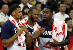 French players react as they near a win over United States during a quarterfinal match for the FIBA Basketball World Cup in Dongguan in southern China's Guangdong province on Wednesday, Sept. 11, 2019. France defeated United States 89-79. (AP Photo/Ng Han Guan)