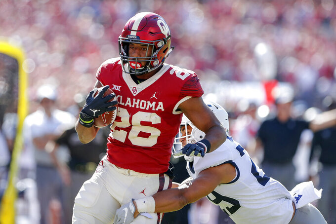 Hurts scores 5 TDs, Sooners roll past West Virginia 52-14