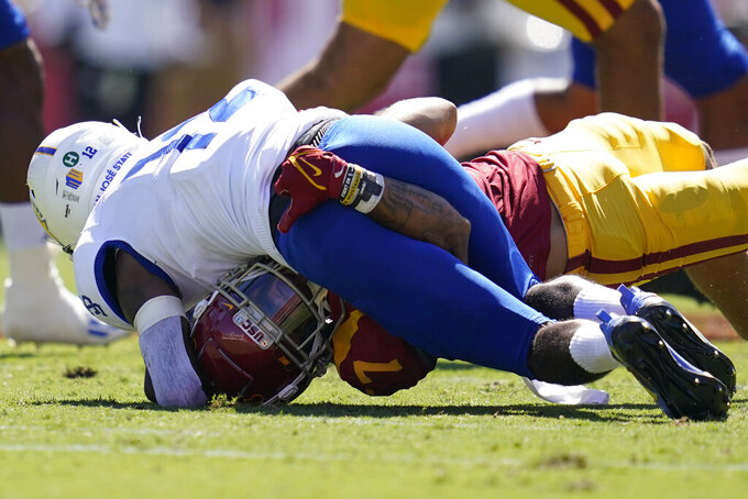Southern California safety Chase Williams (7) tackles San Jose State wide receiver Taariq Johnson (12) during an NCAA college football game Saturday, Sept. 4, 2021, in Los Angeles. (AP Photo/Ashley Landis)