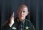 FILE - In this July 10, 2018, file photo, sheriff and chairperson, Bob Gualtieri, of Pinellas county, Fla., speaks during a state commission meeting as they investigate the Marjory Stoneman Douglas High School massacre, in Sunrise, Fla. After a gunman with a history of psychotic behavior killed 17 at a Florida high school two years ago Friday, state lawmakers quickly passed a so-called red flag law that makes it possible for judges, at the request of law enforcement, to ban anyone deemed to be a danger to themselves or others from owning firearms for a year. (AP Photo/Brynn Anderson, File)