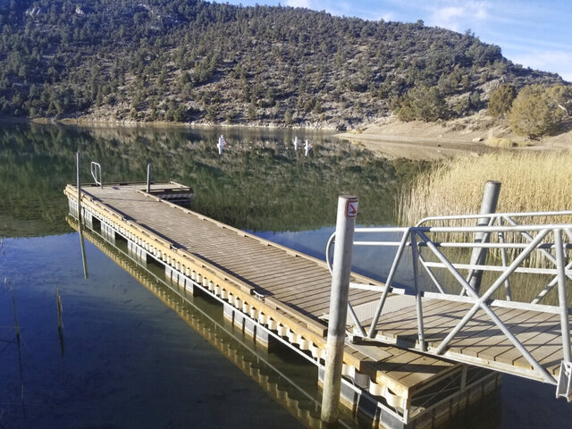FILE - This Wednesday, Nov. 6, 2019, file photo, provided by the Nevada Division of State Parks, shows a boat dock at Cave Lake, a reservoir that was created by the construction of the Cave Creek Dam in 1932, at Cave Lake State Park about 15 miles southeast of Ely, Nev. State officials have completed the first phase of a rehabilitation project at the nearly 90-year-old dam in eastern Nevada where they had found