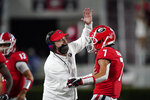 Georgia coach Kirby Smart congratulates wide receiver Jermaine Burton (7) after he scored a touchdown during the first half of the team's NCAA college football game against Auburn, Saturday, Oct. 3, 2020, in Athens, Ga. (AP Photo/Brynn Anderson)