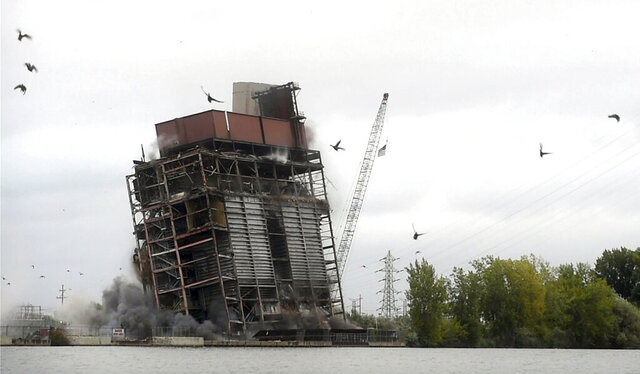 The remnants of the Consumers Energy Weadock Plant are demolished with explosives on Saturday, Aug. 29, 2020 in Hampton Township north of Bay City, Mich.  The plant, which was named for J.C. Weadock, a company founding father, burned about 1 million tons of coal per year and could generate up to 310 megawatts of electricity. (Jake May/The Flint Journal via AP)