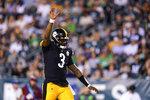 Pittsburgh Steelers quarterback Dwayne Haskins reacts after teammate Jaylen Samuels scores a touchdown during the second half of a preseason NFL football game Thursday, Aug. 12, 2021, in Philadelphia. (AP Photo/Matt Slocum)