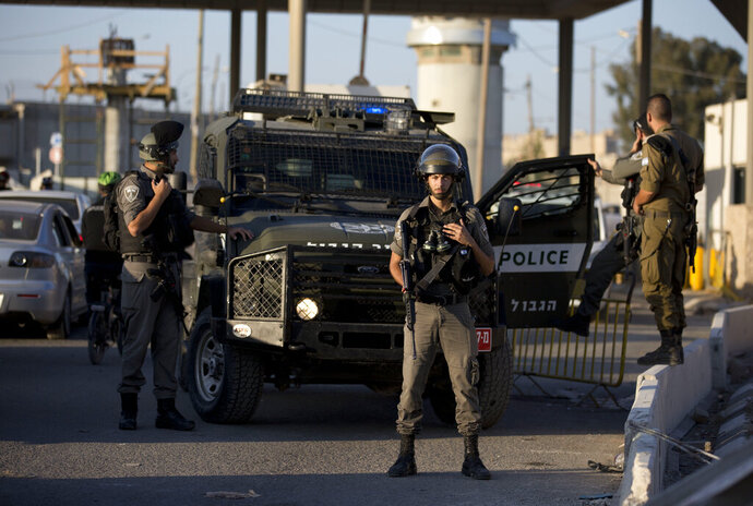 In this Wednesday, Sep. 18, 2019 photo, Israeli police deploy at Qalandia checkpoint after a Palestinian woman was shot and killed by private security guards, near Jerusalem. Israeli police said Thursday that security guards at a checkpoint near Jerusalem were in