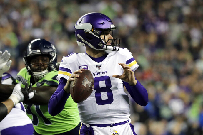 Minnesota Vikings quarterback Kirk Cousins (8) readies a throw against the Seattle Seahawks during the first half of an NFL football game, Monday, Dec. 2, 2019, in Seattle. (AP Photo/Ted S. Warren)