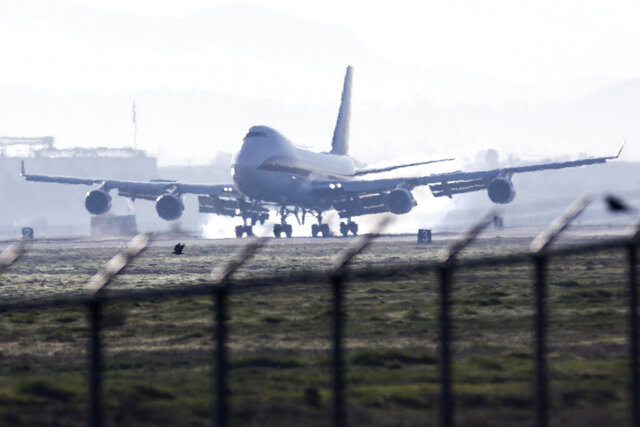 An airplane carrying U.S. citizens being evacuated from Wuhan, China, lands at March Air Reserve Base in Riverside, Calif. Jan. 29, 2020. The passengers will undergo additional screenings in California and be placed in temporary housing. Officials have not said how long they will stay there. (AP Photo/Ringo H.W. Chiu)