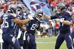 Tennessee Titans tight end Jonnu Smith (81) is congratulated by tight end MyCole Pruitt (85) and quarterback Ryan Tannehill (17) after Smith scored a touchdown against the Tampa Bay Buccaneers in the first half of an NFL football game Sunday, Oct. 27, 2019, in Nashville, Tenn. (AP Photo/James Kenney)