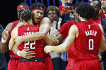 Rutgers guard Ron Harper Jr.. second from left, embraces guard Caleb McConnell (22) after both players were removed during the second half of an NCAA college basketball upset victory over Seton Hall, Saturday, Dec. 14, 2019, in Piscataway, N.J. Rutgers defeated Seton Hall 68-48. Rutgers guard Geo Baker (0) watches, at right. (AP Photo/Kathy Willens)