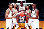 FILE - In this November 1991 file photo, Michigan's Fab Five, from left, Jimmy King, Juwan Howard, Chris Webber, Jalen Rose and Ray Jackson pose in Ann Arbor, Mich. Howard is coming back to Michigan. The former member of the Fab Five agreed to a five-year deal, which will pay him $2 million in his first year, on Wednesday, May 22, 2019, to lead the Wolverines. (AP Photo, File)
