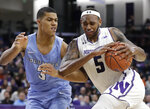 Northwestern center Dererk Pardon, right, drives against Columbia forward Patrick Tape during the second half of an NCAA college basketball game Sunday, Dec. 30, 2018, in Evanston, Ill. Northwestern won 75-54. (AP Photo/Nam Y. Huh)