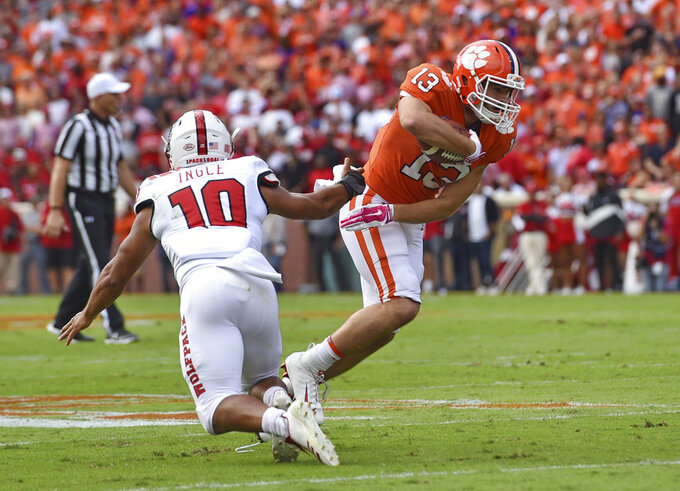 Clemson's Hunter Renfrow avoids the tackle attempt by North Carolina State's Tanner Ingle after a pass reception during the first half of an NCAA college football game Saturday, Oct. 20, 2018, in Clemson, S.C. (AP Photo/Richard Shiro)