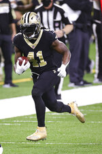 New Orleans Saints running back Alvin Kamara (41) carries the ball during an NFL game against the San Francisco 49ers, Sunday, Nov. 15, 2020 in New Orleans. The Saints defeated the 49ers 27-13. (Margaret Bowles via AP)