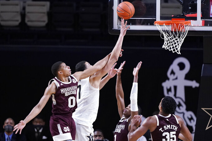 Mississippi State forward Jalen Johnson (0) tries to block a shot by Vanderbilt forward Dylan Disu (1) in the second half of an NCAA college basketball game Saturday, Jan. 9, 2021, in Nashville, Tenn. (AP Photo/Mark Humphrey)