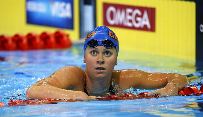 FILE - In this June 27, 2012 file photo, Elizabeth Beisel looks on after swimming in the women's 200-meter individual medley preliminaries at the U.S. Olympic swimming trials in Omaha, Neb. Beisel competed in three Olympics, but she's never taken on a challenge quite like this. Honoring her late father and raising money for cancer research, she's planning to swim more than 12 miles through cold ocean waters to a popular vacation island off the Rhode Island coast. (AP Photo/Mark Humphrey, File)
