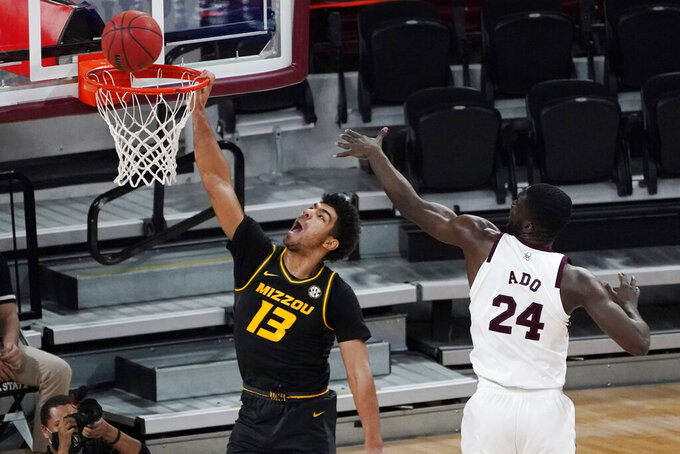 Missouri guard Mark Smith (13) tries for a dunk next to Mississippi State forward Abdul Ado (24) during the first half of an NCAA college basketball game Tuesday, Jan. 5, 2021, in Starkville, Miss. (AP Photo/Rogelio V. Solis)