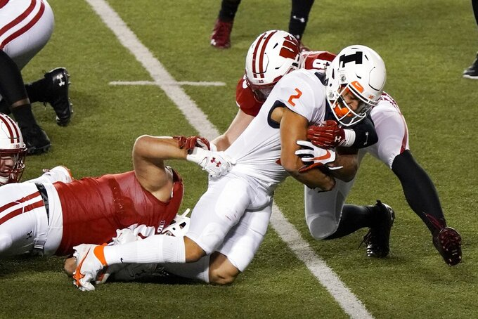 Illinois running back Chase Brown is stopped during the first half of an NCAA college football game against Wisconsin Friday, Oct. 23, 2020, in Madison, Wis. (AP Photo/Morry Gash)