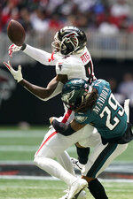 Atlanta Falcons tight end Kyle Pitts (8) misses the catch against Philadelphia Eagles free safety Avonte Maddox (29) during the first half of an NFL football game, Sunday, Sept. 12, 2021, in Atlanta. (AP Photo/Brynn Anderson)