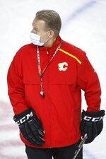 Calgary Flames head coach Geoff Ward wears a mask during NHL hockey practice in Calgary, Alberta, Tuesday, Jan. 5, 2021. (Jeff McIntosh/The Canadian Press via AP)