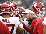 Oklahoma head coach Lincoln Riley gives instructions to his players during the first half of an NCAA college football game against TCU, Saturday, Oct. 20, 2018, in Fort Worth, Texas. Oklahoma won 52-27. (AP Photo/Brandon Wade)