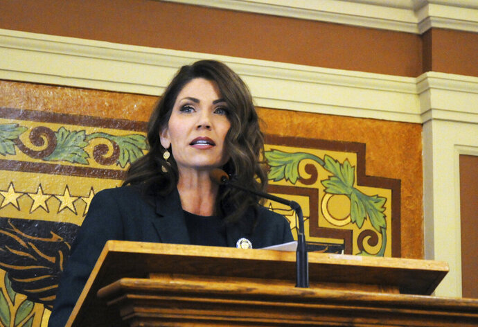 FILE - In this Jan. 23, 2019, file photo, Gov. Kristi Noem gives her first budget address to lawmakers at the state Capitol in Pierre, S.D. Noem will use her State of the State address to pitch prospective businesses on why they should move to South Dakota, the Republican governor told The Associated Press in an exclusive interview on Sunday, Jan. 12, 2020. (AP Photo/James Nord, File)