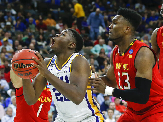 LSU's Darius Days, left, looks for a shot in front of Maryland's Bruno Fernando (23) during the first half of a second-round game in the NCAA men's college basketball tournament in Jacksonville, Fla., Saturday, March 23, 2019. (AP Photo/Stephen B. Morton)
