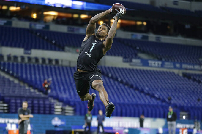Ohio State defensive back Damon Arnette runs a drill at the NFL football scouting combine in Indianapolis, Sunday, March 1, 2020. (AP Photo/Michael Conroy)