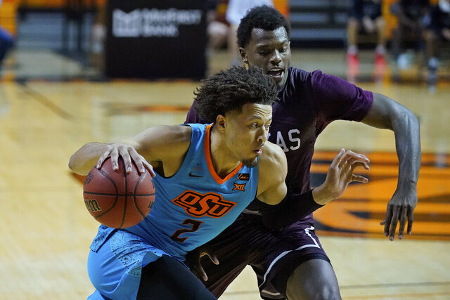 Oklahoma State guard Cade Cunningham (2) drives past Texas Southern forward Galen Alexander during the second half of an NCAA college basketball game in Stillwater, Okla., Saturday, Nov. 28, 2020. (AP Photo/Sue Ogrocki)