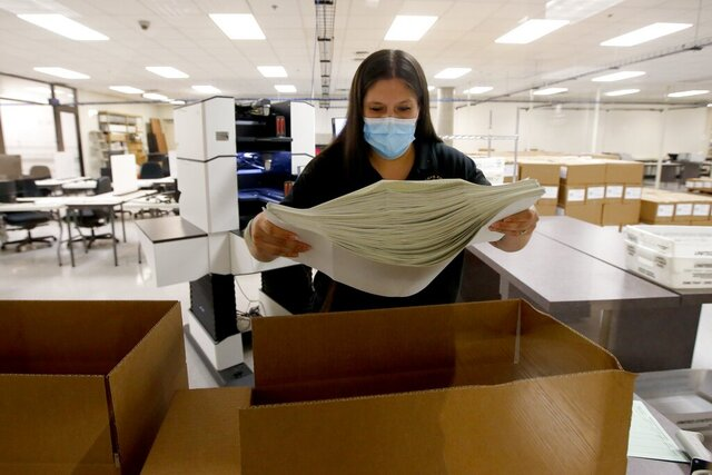 Ballots are boxed up after votes were counted at the Maricopa County Recorder's Office for the primary election Tuesday, Aug. 4, 2020, in Phoenix. (AP Photo/Ross D. Franklin)