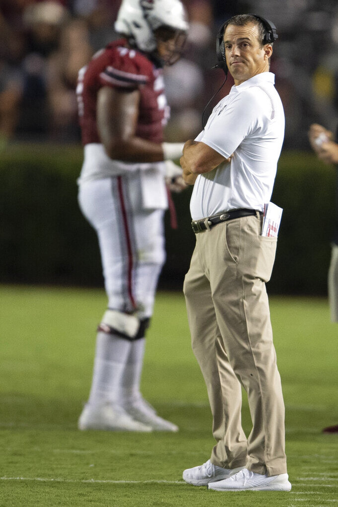 South Carolina head coach Shane Beamer watches the scoreboard during the second half of an NCAA college football game against Eastern Illinois, Saturday, Sept. 4, 2021, in Columbia, S.C. (AP Photo/Hakim Wright Sr)