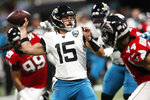 Jacksonville Jaguars quarterback Gardner Minshew II (15) works in the pocket against the Atlanta Falcons during the first half of an NFL football game, Sunday, Dec. 22, 2019, in Atlanta. (AP Photo/John Bazemore)