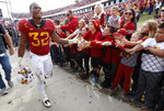 Iowa State running back David Montgomery (32) celebrates with fans after an NCAA college football game against Texas Tech, Saturday, Oct. 27, 2018, in Ames, Iowa. (AP Photo/Charlie Neibergall)