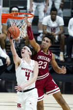 Rutgers' Paul Mulcahy (4) has his shot blocked by Indiana's Trayce Jackson-Davis (23) during the second half of an NCAA college basketball game at the Big Ten Conference tournament, Thursday, March 11, 2021, in Indianapolis. (AP Photo/Darron Cummings)