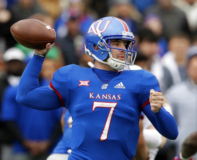 Kansas quarterback Peyton Bender (7) passes to a teammate during the first half of an NCAA college football game against Texas in Lawrence, Kan., Friday, Nov. 23, 2018. (AP Photo/Orlin Wagner)