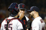 Cleveland Indians pitching coach Carl Willis, center, speaks with catcher Roberto Perez, left, and relief pitcher Nick Goody after Goody walked Washington Nationals' Kurt Suzuki to load the bases in the sixth inning of a baseball game, Friday, Sept. 27, 2019, in Washington. (AP Photo/Patrick Semansky)