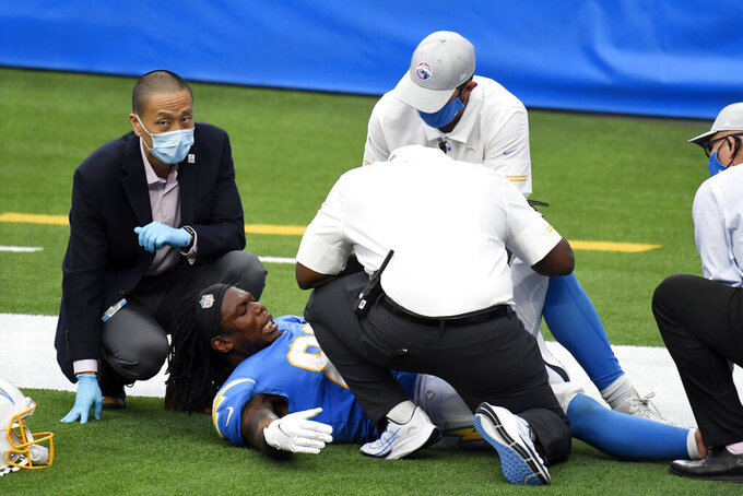 Los Angeles Chargers tight end Virgil Green is injured after catching a touchdown pass against the Jacksonville Jaguars during the second half of an NFL football game Sunday, Oct. 25, 2020, in Inglewood, Calif. (AP Photo/Kyusung Gong)