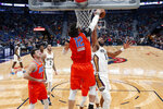 Oklahoma City Thunder center Steven Adams (12) blocks a shot by New Orleans Pelicans center Jahlil Okafor (8) in the first half of an NBA basketball game in New Orleans, Sunday, Dec. 1, 2019. (AP Photo/Gerald Herbert)