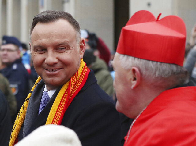 Polish President Andrzej Duda, left, and Archbishop of Warsaw Cardinal Kazimierz Nycz attend the 12th annual Epiphany procession in Warsaw, Poland, Monday, Jan. 6, 2020. Epiphany, the 12th night of Christmas, marks the day the three kings visited Christ. (AP Photo/Czarek Sokolowski)