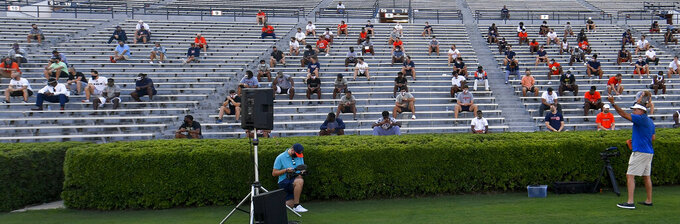 Auburn coach Gus Malzahn, right, talks to players during the first team meeting of the season for the NCAA college football team, Sunday, Aug. 16, 2020 in Auburn, Ala. (AP Photo/Todd Van Emst)