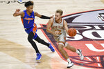 Boston College's Rich Kelly is guarded by Florida's Tre Mann during the first half of an NCAA college basketball game Thursday, Dec. 3, 2020, in Uncasville, Conn. (AP Photo/Jessica Hill)