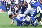 Denver Broncos quarterback Joe Flacco (5) is sacked by Indianapolis Colts' Ben Banogu (52) during the first half of an NFL football game, Sunday, Oct. 27, 2019, in Indianapolis. (AP Photo/AJ Mast)