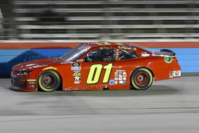 Stephen Leicht heads into the front stretch during NASCAR Xfinity auto race at Texas Motor Speedway in Fort Worth, Texas, Saturday, Nov. 2, 2019. (AP Photo/Randy Holt)