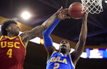 UCLA forward Cody Riley, right, grabs a rebound away from Southern California guard Kevin Porter Jr. during the first half of an NCAA college basketball game Thursday, Feb. 28, 2019, in Los Angeles. (AP Photo/Mark J. Terrill)